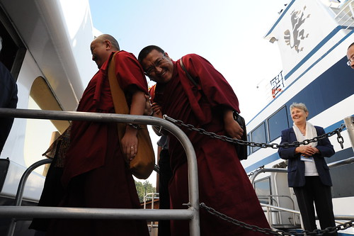 Changling Rinpoche hiding and laughing behind a fellow monk, while boarding the cruise ship on the gangplank, Vancouver BC Harbor, Lotus Speech Canada by Wonderlane