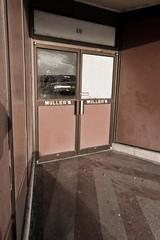 619 Ryan Street (Daniel Ray) Tags: door broken window glass store holes bullet entry mullers
