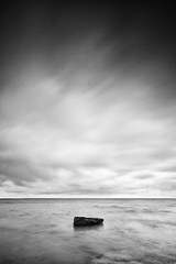 One Rock - Plenty (Rob Ferrol) Tags: blue sea sky seascape black rock sunrise dawn one bay coast seaside rocks long exposure solitude moody fineart overcast minimal east whitby lonely nab sandbeach saltwick yoarkshire minimalistyorkshire