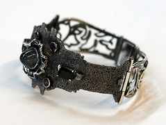 To Rococo Rot 11 (the justified sinner) Tags: silver leaf rust steel jewelry jewellery bracelet bangle quartz magnet foundobject corrosion quartzite gem rococo garnet gemstone escutcheon spinel justifiedsinner