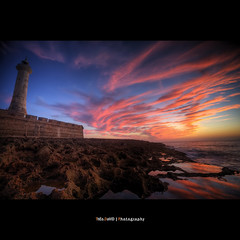 Pink Hour (Feo David) Tags: ocean pink blue sunset sea sky cloud sun mer lighthouse mountain reflection nature water clouds canon dark eos soleil rocks view ciel morocco maroc marocco 5d nuages rabat afrique atlantique pharederabat