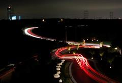 Winding through Austin (JTRoboPhoto) Tags: nightphotography motion night canon dark lights movement long brakes xsi longexpusure carheadlights canon1855mm nightowl nightcars headlightscars canondigitalrebelxsi endlessexposure lightstail expsurepassingwooshredwhitebrake