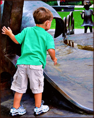 The kid in the green shirt. (blamstur) Tags: green kid child massachusetts frombehind springfield drseuss photographyrocks 15challengeswinner drseussnationalmemorialsculpturegarden