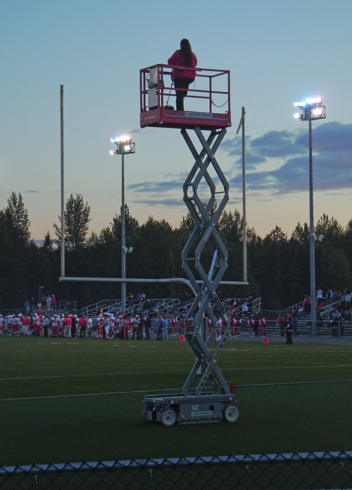 photographer at high school football game, Anchorage, Alaska