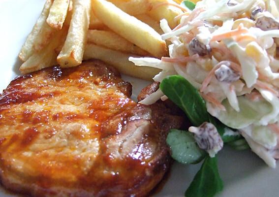 Fries, porkchop and coleslaw