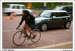 Hectic streets (Ilan Shacham) Tags: street uk greatbritain england london cars bicycle speed hair beard cycling moving nikon afternoon mini minor panning flickrmeet d90 flickrwalk