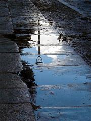 September Rain (onnola) Tags: street sky cloud reflection tree berlin water lamp rain kreuzberg germany puddle deutschland wasser streetlamp pavement himmel wolke spiegelung baum regen reflektion bürgersteig pfütze strase strasenlaterne strasenlampe