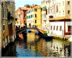 Venice, the flattering and suspect beauty. A fairy tale.... (jackfre2 (on a trip-voyage-reis-reise)) Tags: bridge flowers venice houses red italy beauty reflections boats canal italia colours terraces charm tourists roofs venezia palaces gondolas