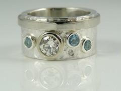 Stone set hammered band ring