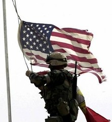US Arrogance - Soldier raising USA flag