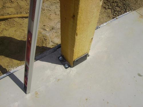 Steel brackets hold the posts in place
