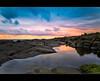 Forgotten sunset... (Chantal Steyn) Tags: ocean longexposure pink light sunset sea lighthouse reflection water grass clouds landscape southafrica photography coast nikon rocks tripod tidalpool 30sec portedward kwazulunatal d300 nohdr gnd8 1685mm chantalsteyn leascape