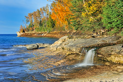"""Miners Gem"" Miners Beach Falls , Pictured Rocks National Lakeshore, Michigans upper  peninsula (Explore # 146 Oct. 8, 2010) (Michigan Nut) Tags: longexposure autumn sunset orange usa beach landscape photography photo waterfall nikon rocks photos michigan cliffs explore lakesuperior recent orangeleaves picturedrocksnationallakeshore d700"