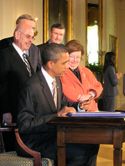 President Barack Obama signing a bill into law