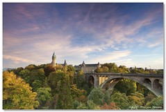 Autumn's here - Grand Duchy of Luxembourg, Luxembourg (Pipall) Tags: bridge blue autumn trees sunset sky canon lens landscape eos soft boulevard cityscape arch angle dusk wide royal bank foundation foliage filter 09 valley lee nd luxembourg polarizer 06 grad 1740mm hitech ville circular holder haute hoya pontadolphe caissedpargne spuerkess ptrusse avenuedelalibert 5dmarkii 4l