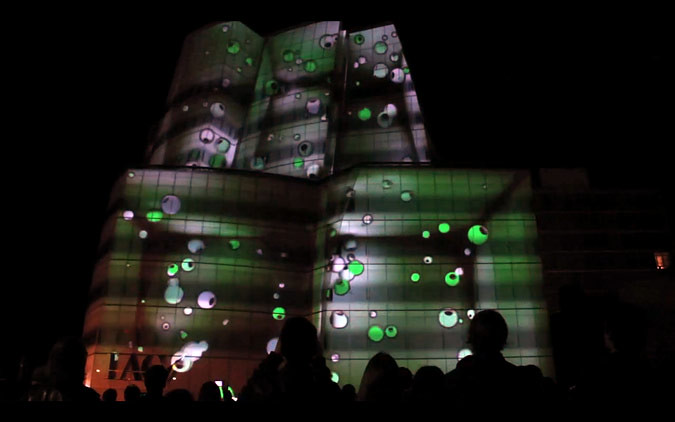 IAC Building projection by seeper. (Via Dan Ilic / Vimeo)