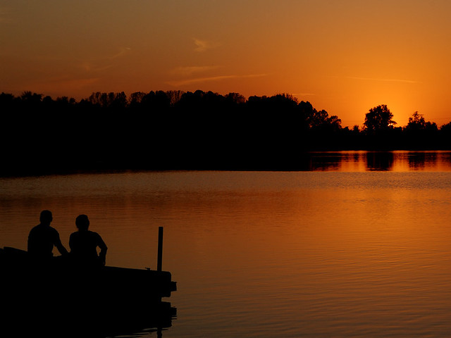 Creve Coeur Lake, in Maryland Heights, Missouri, USA - couple gazing into the sunset