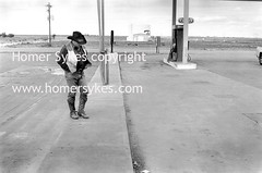 COWBOY DENTON TEXAS On the Road Again. BOOK BY HOMER SYKES USA. (Homer Sykes) Tags: life road street urban horse usa cowboys america real photography us cowboy alone texas unitedstates no candid streetphotography daily again american homer lone americana lives lonely middle denton sykes on lonesome again on homer sykes