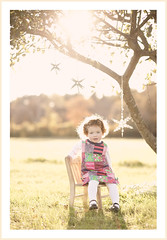 pretty little thing (BelliniPortraits) Tags: sunset tree girl vintage stars toddler dress rockingchair 2yearsold sunflare belliniportraits bellinipics