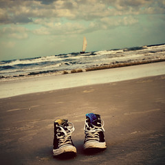 A day at the beach. {Explored} (eRachel11) Tags: ocean beach water boat sand nikon florida converse daytonabeach chucks stormysky allstars wormseyeview nikond7000 happysliderssunday brightbluesocks