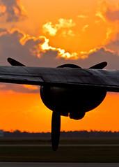 Glowing Sky (JoelICastaneda) Tags: sunrise aircraft wwii airshow bomber propeller warbirds 2010 b24liberator ol927 wingsoverhoustonairshow sunrisephotoop