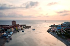 Tilt-shifted Willemstad, Curacao (clee130) Tags: ocean travel bridge sunset sea sun color travelling water netherlands set ferry lens landscape geotagged lumix colorful ant shift queen panasonic curacao 17 caribbean pancake 20mm juliana tilt curaçao ferries willemstad handelskade dmc antilles netherlandsantilles tiltshift punda f17 m43 gf1 mft otrobanda queenjulianabridge motleypixel micro43 microfourthirds dmcgf1 panasonicdmcgf1