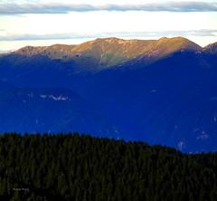 Sunrise (Robyn Hooz) Tags: italy sun montagne canon italia nuvole zoom alba beam cielo foresta pini veneto raggio pianezze prealpi 550d 55250 sorgere efs55250is