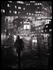 The city. The lights. The rain. (Sascha Unger) Tags: street autumn light people urban blackandwhite bw berlin art fall window rain weather silhouette architecture night kreuzberg germany licht traffic angle fenster centre herbst perspective center menschen stadt sascha architektur sw mitte verkehr regen wetter perspektive multiexposure iphone nachts pictureshow schwarzweis kochstrase sascha2010 saschaunger