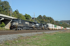 Three General Electric C40-9W 4000 horsepower locomotives lead a Norfolk Southern westbound container train, on ex-PRR, ex-PC, ex-Conrail trackage, Rochester, Pennsylvania, October 9, 2010. NS acquired 1,090 of these locomotives between 1996 and 2004. (Ivan S. Abrams) Tags: railroad train pc pittsburgh pennsylvania ns trains container locomotive freighttrains locomotives containers railroads beavercounty generalelectric prr freighttrain norfolksouthern conrail westernpennsylvania pennsylvaniarailroad penncentral alleghenycounty jbhunt c409w dieselelectriclocomotive containertrain intermodaltrain dieselelectriclocomotives ivansabrams intermodaltrains containertrains rochesterpennsylvania conwayyard abramsandmcdanielinternationallawandeconomicdiplomacy ivansabramsarizonaattorney ivansabramsbauniversityofpittsburghjduniversityofpittsburghllmuniversityofarizonainternationallawyer