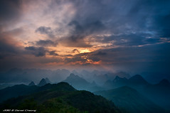 Sunburst over the Karst Mountains (DanielKHC) Tags: china sky mountain mountains digital sunrise landscape interestingness high nikon bravo dynamic guilin hill scenic dramatic front beam explore page sunburst layers karst range fp dri hdr blending guanxi d300 yaoshan danielcheong danielkhc tokina1116mmf28