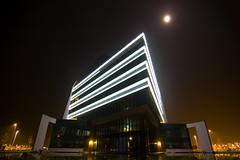Glowing (bobbrink) Tags: longexposure light moon building night canon lights licht 300d glow nederland tokina le 1224 gebouw assen messchenveld