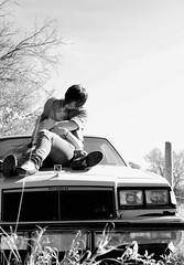 I can hardly breathe. (Jennifer.Galea) Tags: trees boy sky blackandwhite bw 3 love boyfriend girl car canon outside shoes kiss girlfriend couple post expression relationship feeling oldcar carhood girlandboy girlfriendandboyfriend