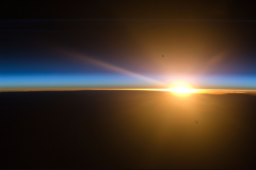 Incredible Photos from Space: Thin layer of noctilucent clouds at sunset