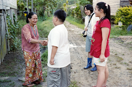 Shake hand with old Kelabit woman