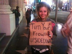 Look at this homeless girl's sign and try not to smile