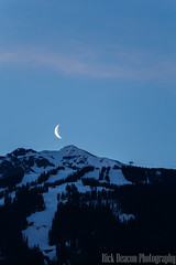Moon Rising Over Whistler Blackcomb (Rick Deacon) Tags: blackcomb blue crescent dawn daybreak half moon moonrise mountain pastel peaceful peak rise whistler white
