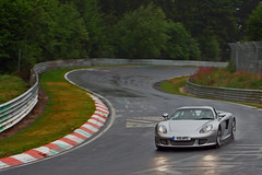 Porsche Carrera GT on a wet Nordschleife (Martijn Kapper) Tags: green wet rain canon germany eos 26 hell july exotic rainy porsche british groene 07 hel 2010 carreragt 612 tf nordschleife nurburgring bhp nrburg nurburg touristenfahrten