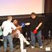 Exchanging baseball hats- Ian Padron and Michael Moore