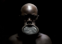 Shaved Surma woman with lip plate - Ethiopia (Eric Lafforgue) Tags: light portrait woman beauty face artistic head culture tribal ornament clay tribes bodypainting tradition tribe ethnic rite surma bodymodification tribo labret adornment pigments ethnology tribu eastafrica thiopien suri etiopia ethiopie etiopa 3784  etiopija ethnie ethiopi  lipplug lipplate etiopien etipia  etiyopya  nomadicpeople      lipdisc    peoplesoftheomovalley piercedhole piercedlipornament