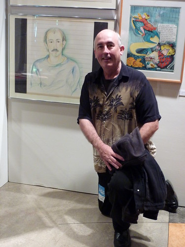 John Keister with his portrait by Lynda Barry, Counterculture Comix exhibit, Bumbershoot 2010