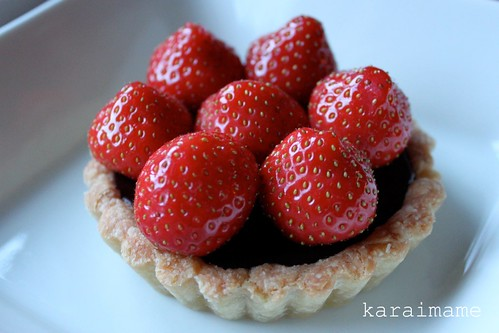 Chocolate ganache tartlet with strawberries