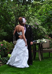 Husband and Wife (Photography Through Tania's Eyes) Tags: flowers wedding canada gardens table groom bride photo nikon photographer bc veil britishcolumbia okanagan picture husband pearls photograph wife okanaganvalley kaleden newbeginning chiars copyrightimages lindengardens weddingdresss taniasimpson