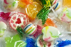 lollipops (friendlydrag0n) Tags: blue red food orange white color colour green yellow fruit children recipe dessert rainbow junk colorful candy heart image sweet background fat sticky group hard stripe tasty valentine sugar eat snack round treat colourful lollipop lollypop wrapper unhealthy confection cellophane enumber