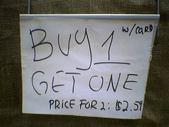 "Supermarket ""sale"" sign: ""BUY 1..."