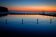 Reflections of a new Beginning (Visual Clarity Photography) Tags: sky cloud reflection beach pool sunrise fence dawn spring nikon au australia adobe newport nsw newsouthwales nikkor 2010 hoya lightroom d300 oceanbath oceanpool gp1 uvfilter 2106 capturenx bilgolabeach uv0 nikkor1685f3556gedvr capturenx2 lightroom32 1685f3556edvr superhmcpro1 3002056