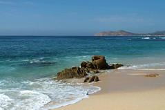 there's oceans in between us, (breanna) Tags: ocean blue sea mountain slr beach water mexico cabo nikon rocks aqua waves pacific teal footprints pacificocean foam cabosanlucas d5000 nikond5000