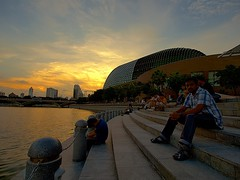 Esplanade Sunset (HaIogen) Tags: sunset people water singapore wideangle olympus esplanade 2010 marinabay singaporeskyline zd blendedexposures e520 918mm