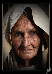 It ought to be lovely to be old, To be full of the peace that comes with experience And wrinkled ripe fulfillment (Muhammad Fahad Raza) Tags: street old light portrait woman photography eyes lowlight expression low streetphotography streetportrait oldwoman features punjab ahmed wrinkles imran wrinkled rawalpindi muslimwoman ppa maskeen behindtheveil ishtiaq zuikodigital50mmf20 ishtiaqahmed poznflik imranmaskeen pakistaniphotographersassociation wrinkledwoman pakistanipublic alleysofrawalpindi fsuro270910031010