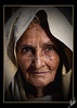 """It ought to be lovely to be old, To be full of the peace that comes with experience And wrinkled ripe fulfillment"" (Muhammad Fahad Raza) Tags: street old light portrait woman photography eyes lowlight expression low streetphotography streetportrait oldwoman features punjab ahmed wrinkles imran wrinkled rawalpindi muslimwoman ppa maskeen behindtheveil ishtiaq zuikodigital50mmf20 ishtiaqahmed poznflik imranmaskeen pakistaniphotographersassociation wrinkledwoman pakistanipublic alleysofrawalpindi fsuro270910031010"