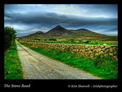 The Stone Road (Irishphotographer) Tags: ireland hills stonewall mournemountains irishart codown irishphotographer imagesofireland grassyroad kimshatwell thestoneroad wwwdoublevisionimageswebscom